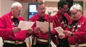 Members of the Larchmont Historical Fire Company Donny Keck, Ned Benton, PJ Abrahamsen and Jim Sweeney (l-r) serenade their Hose Company guests with a firefighting ditty.